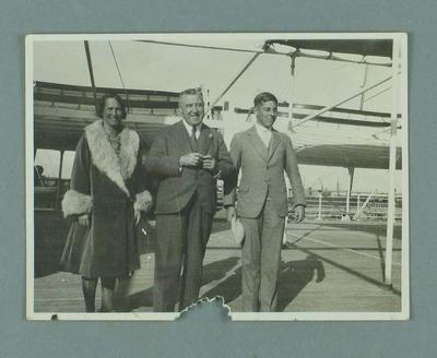 Photograph of Lily Beaurepaire onboard a passenger liner, with two men