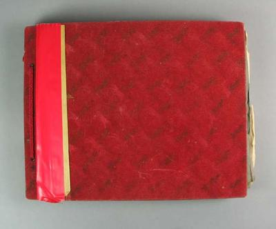 Red Album/scrapbook with career records of cyclist Valda Unthank