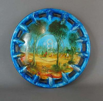 Plastic hub cap, with oil painting depicting cricket match by Pro Hart on front