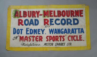 Banner celebrating Albury-Melbourne Road Record, held by Dot Edney c1938