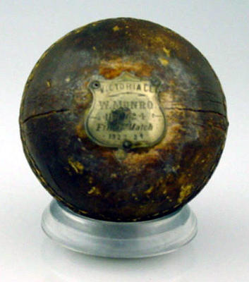 """Cricket ball with silver plaque: """"Victoria CC, W. Munro, Ballarat 1923-24"""""""