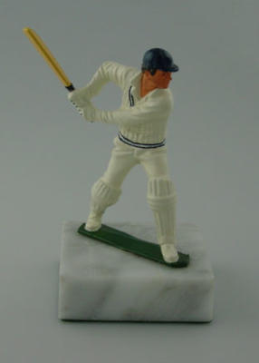 Figurine of a batsman about to play a stroke