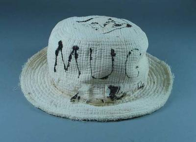 A white hat worn by Eric Gibaud during the Six-Day Cycle Race in Sydney 1925-6.