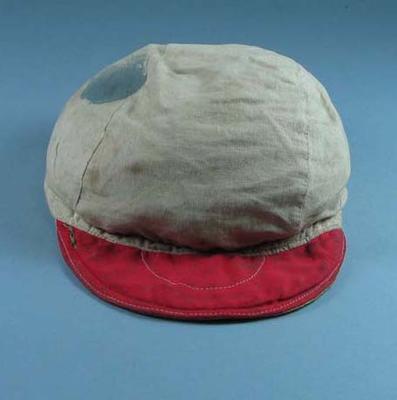 White cap worn by cyclist Russell Mockridge on the Sun Tour, circa 1955