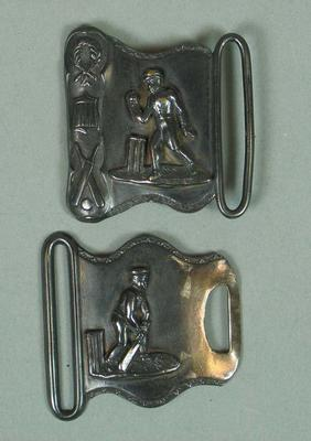 Two piece metal belt buckle, featuring images of cricketers c1865