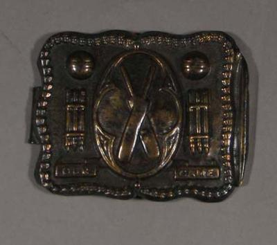 Metal belt buckle, featuring images of cricketers c1870