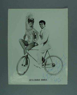 Black and white photograph of cycling entertainers Liz & Charlie Charles with handwritten inscription