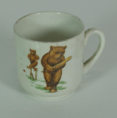 Cup, design features bears playing cricket