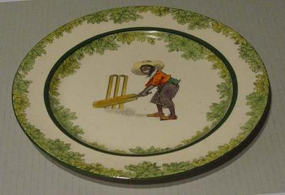 Plate, depicts boy cricketer; Domestic items; M5033