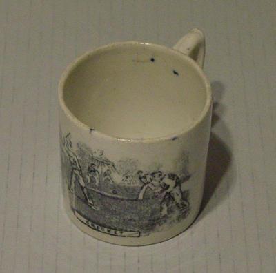 "Child's mug, cricket design with ""Cricket"" below the scene"
