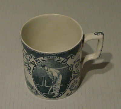 Ceramic mug, images of two cricketers with  'Australia' above; Domestic items; M5132