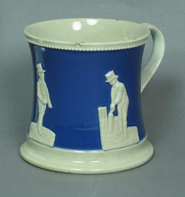 Ceramic mug, relief design of three cricketers