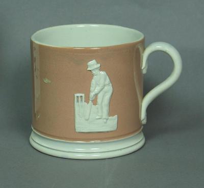 Ceramic mug, relief design of two cricketers