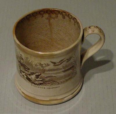 Ceramic mug, cricket and wild duck shooting scenes