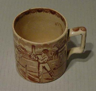 Ceramic mug, cricket and rugby scenes; Domestic items; M5147