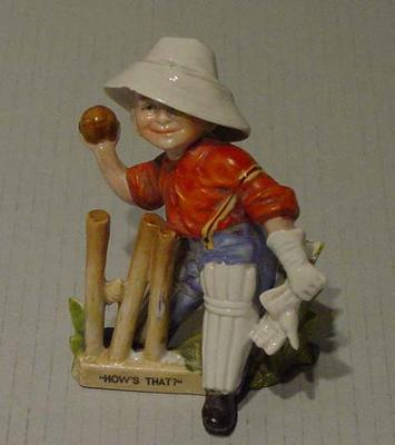 """Boy cricketer figurine titled:   """"How's That"""""""