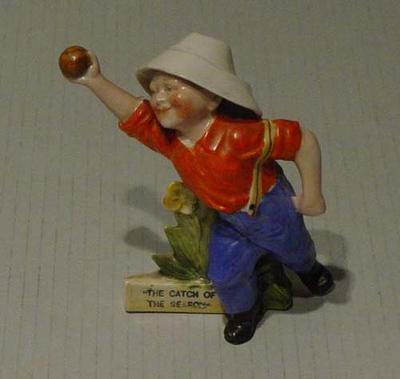 """Boy cricketer figurine titled:   """"The Catch of the Season"""""""