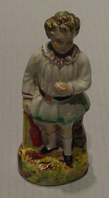 Figurine, depicts a boy with cricket bat