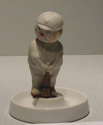 Ashtray, cricketer figurine