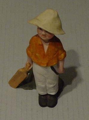 Figurine, boy playing cricket