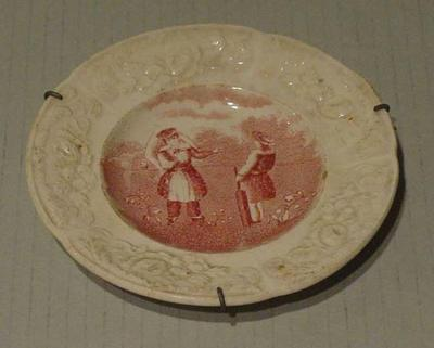 Ceramic plate featuring Victorian scene of girls playing cricket