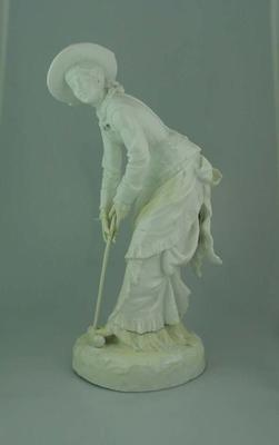 Ceramic Staffordshire figurine of a girl with croquet stick and ball, 1878; Domestic items; M5315.2