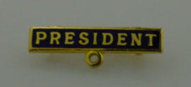 Metal pin badge with 'President' in gold letters - belonged to Hans I. Ebeling