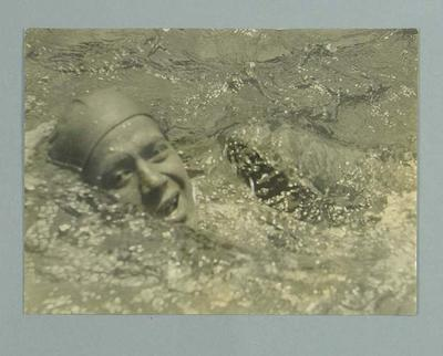 Photograph of a swimmer, during a race
