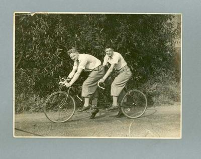 Black and white photograph of Ernie Milliken and Wally Stuart on their tandem at BSA Testing Track 1935