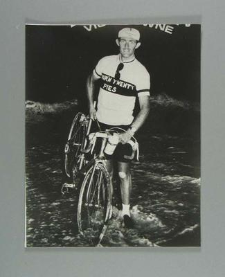 Black and white enlarged photographic copy of promotional postcard of champion cyclist Vic Browne, during his record ride Perth/Sydney April 1967