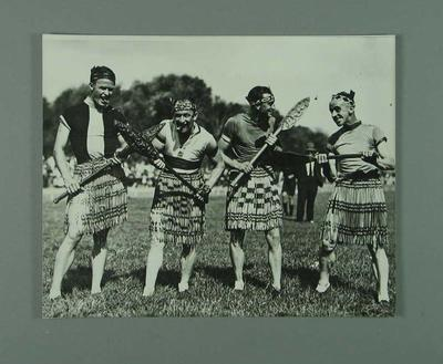 Black and white photographic copy depicting N. Moritz, H. Turtill, P. Veitch, E. Gibaud dressed as Maoris during a New Zealand Tour