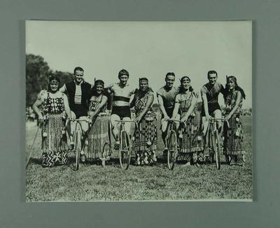Black and white photographic copy depicting N. Moritz, H. Turtill, P. Veitch, E. Gibaud on bicycles during a New Zealand Tour