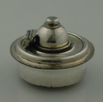 Silver burner - Presented to G. Peckham Beachcroft by  Melbourne Football Team 1907