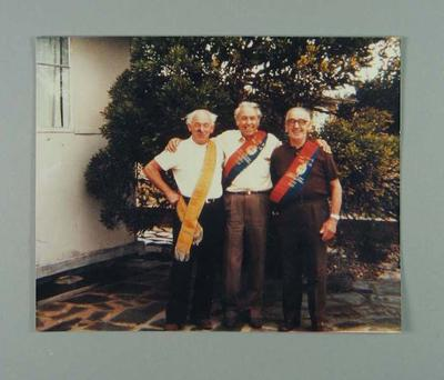 Colour photographic copy showing Ernie Gibaud, Hubert Turtill and Eddie Smith wearing Bob Spears' World Championship sashes and Grad Prix sash, c.1975; Photography; 1986.205