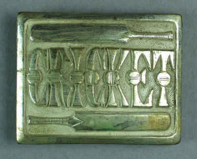 "Belt buckle inscribed: ""Cricket"""