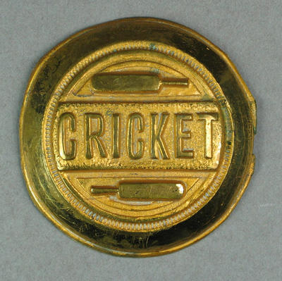 "Brass disc/belt buckle,  with inscription ""Cricket"""