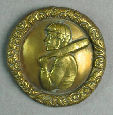 Belt buckle, image of cricketer