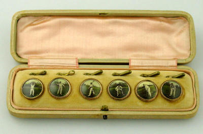 Jewellery case housing 6 cricket image shirt buttons with their keepers