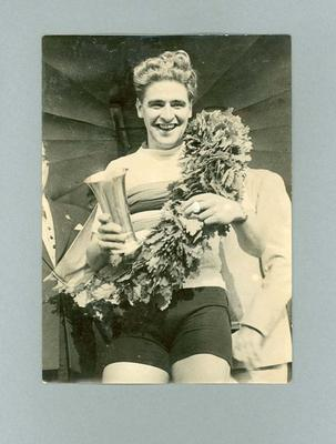 Photograph of Sid Patterson being presented with the 1949 World Amateur Sprint Championship singlet; Photography; 1986.1145.1