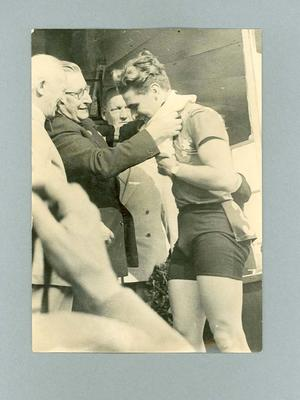 Photograph of Sid Patterson being presented with the 1949 World Amateur Sprint Championship singlet; Photography; 1986.1145.2