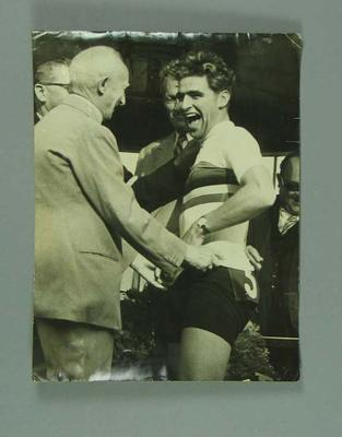 Photograph of Sid Patterson being presented with the 1949 World Amateur Sprint Championship singlet; Photography; 1986.1146