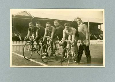 Black and white, sepia toned, photograph featuring Cyclists at Start of Race