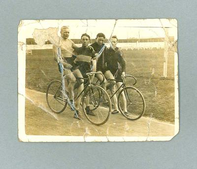 Black and white photograph  of four cyclists - Track in Sydney 5 Nov 1916