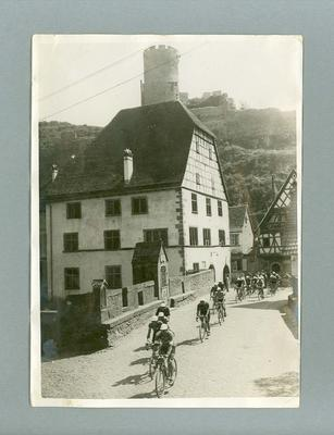 Black and white photograph of cyclists during the Tour De France in 1928