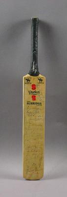 Miniature bat, autographed by Australian & English cricketers