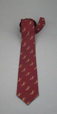 Tie - maroon with white cricket bat through yellow bracket - club unknown