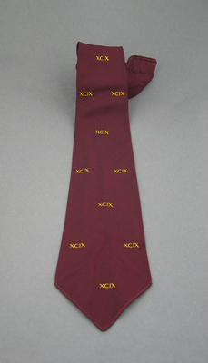 """Maroon silk tie with letters """"XCIX"""" repeated - club unknown"""