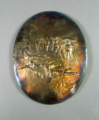 Oval silver plaque depicting shooters
