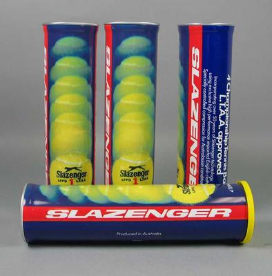 Four empty cylindrical metal containers, previously holding four Slazenger tennis balls