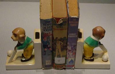 Bookends, depict dogs with cricket equipment